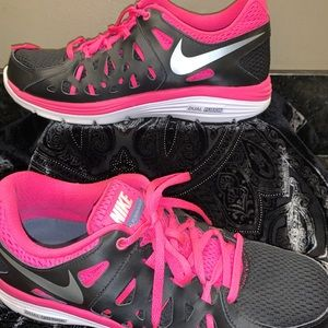 Nike pink and black running shoes.